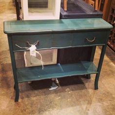 A bit of color for an entryway. Put baskets on the bottom shelf for storage. SCC024, $156. #fwas #console #entryway #turquoise #blue #green