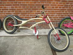 Lovely sandy cream and deep red paint job on this custom cruiser. Origin unknown?!
