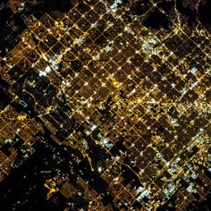 3/28/2015 Phoenix at night Phoenix, Arizona, USA 33°27′N112°04′W  Wondering what Phoenix looks like right now? The city's metropolitan area is seen here, captured at night from the International Space Station. The city is laid out along a regular grid of blocks and avenues that are strikingly outlined by streetlights at night. This type of urban plan encourages growth of a city outwards along its borders by providing optimal access to new real estate.
