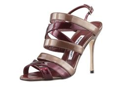 "$885 - Mimkema Strappy Patent Sandal, Bordeaux/Copper  Swirling straps of bordeaux and copper leather lend this Manolo Blahnik Mimkema sandal a palette-able presentation. Two-tone patent leather with subtle metallic sheen. 4"" covered heel; single sole. Strappy front with open toe. Buckled slingback strap. Leather lining and sole. ""Mimkema"" is made in Italy."