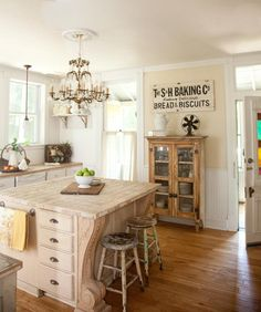 Love the fancy schmancy corbels and chandelier combined with the super rustic simple cabinetry and beadboard.  Nice! Circa 1865 Missouri Farmhouse Kitchen | Midwest Living
