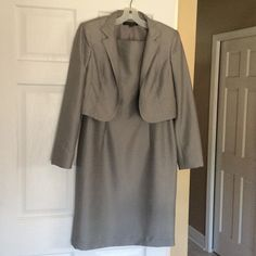 WEEKEND SALE ‼️⬇️ Anne Klein dress with jacket Beautiful Anne Klein dress with jacket. Shimmery gray color... Beautiful condition!! Dress zips up back. Anne Klein Dresses Midi