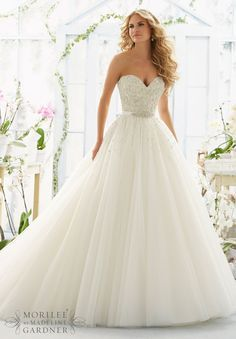Wedding Dresses and Wedding Gowns by Morilee featuring Pearl and Diamante Beading on Laser Cut Embroidery onto a Tulle Ball Gown Removable Beaded Satin Belt. Colors available:White, Ivory, Ivory/Light Gold, Ivory/Blush.