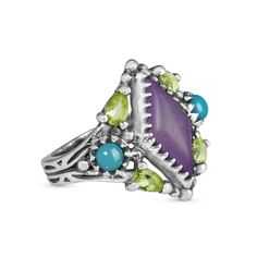 Pack some pizzazz into your wardrobe with the lively colors of a Southwest fiesta. The pop of color in the center of this ring is a diamond-shaped purple magnesite cabochon, set into a serrated bezel. Accent stones of blue turquoise and faceted peridot gemstones provide an unexpected color combinati