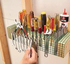 woodworking tools Hardware Cloth Tool Roost — The Family Handyman - Store just about every hand tool you need on a strip of vinyl-coated wire mesh hardware cloth. Make a frame from a scrap of plywood. Garage Organisation, Garage Tool Storage, Workshop Storage, Garage Tools, Shed Storage, Storage Ideas, Workshop Ideas, Garage Shop, Kitchen Storage