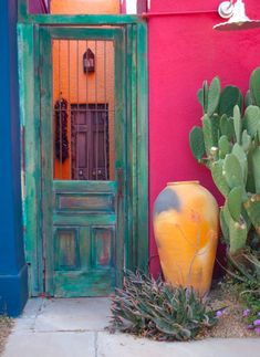 sw green cactus, yellow urn, pink wall, white lamp, teal rustic door, peach wall, purple door, lantern