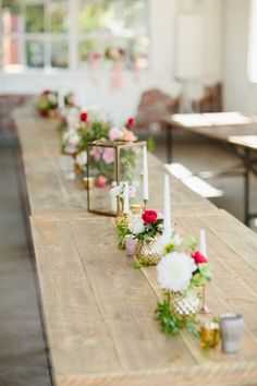 modern simple centerpieces - photo by Sara and Rocky Photography http://ruffledblog.com/stylish-and-light-fall-wedding