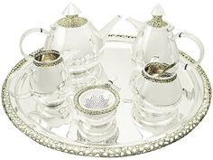 An exceptional, fine, impressive, large and unusual vintage Elizabeth II English sterling silver six piece design tea and coffee service made by Ian Calvert. SKU: A2327 Price: GBP £12,950.00 #tea #coffee #service #sterlingsilver #ElizabethII #IanCalvert