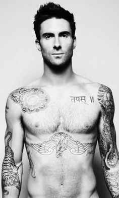 Adam Levine *phew*...I know the body double for his recent video. So awesome to see Dan with all the same tats as Adam!