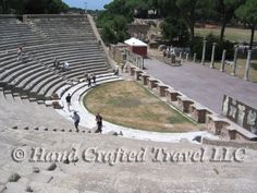 Travel Picture: Day 192. The theater at Ostia Antica, Italy. The Greeks loved the theater, but needed a hillside to create the necessary shape for the seating. The Romans refused to let something as simple as flat ground keep them from enjoying the theater, so they built artificial hills from concrete to support the seating.