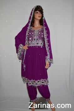 """Gorgeous violet Afghan dress that is decorated with an elegant mirrored embroidery and trimmed with silver sequins and dangling bells. Perfect to wear to special occasions and parties. Comes with matching headscarf and pants.  Measurements: The full length measures 36"""" inches from the back center of the neck to the bottom, and the width at the bust is 18"""" inches at the front panel from seam to seam.  http://www.zarinas.com/dresses_fancy.shtml"""