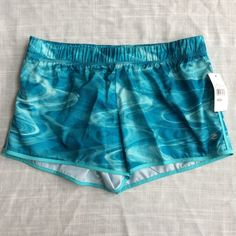 New Teal Blue Running Shorts Brand new with tags. Inner drawstring. No pockets. Retail $25.99. Available in sizes medium and XL. Shorts