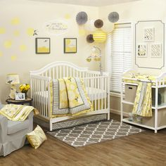 The Stella 4 Piece Set includes a quilt, dust ruffle, cotton fitted crib sheet and diaper stacker. An arrangement of 100% cotton sateen graphic and floral prints in a fresh palette of yellow and gray will create a stunning nursery for a little girl.