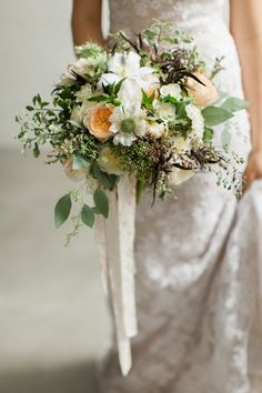White, peach and green bridal bouquet with garden roses, scabiosa, dahlias and clematis by Foraged Floral in Portland, Oregon.