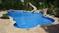 In Ground Pool Featuring A Vinyl Liner Hardscape Fencing