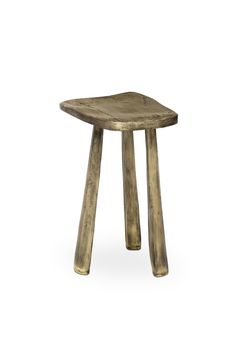 Dolmens are megalithic tombs that usually consist of upright stones supporting a large flat horizontal one. The impressive structure inspired the creation of DOLMEN Stool, a unique furniture design piece. This brass stool, with three legs and made of polish casted brass, will make a statement in any modern home decor.