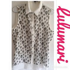 LULUMARI SKULL TOP SIZE LARGE Awesome Top!!! LULUMARI Size Large...  Skulls cover this Sleeveless Blouse with a Sheer back!  In excellent condition, you will be very pleased! Lulumari Tops Tank Tops