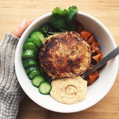 Lunch Bed of roasted veggies (onions zucchini carrots) // a homemade White Bean Swiss Chard veggie burger // cucumbers & sea salt // homemade hummus by thelittleflowerpetal