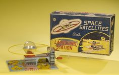 I had one of these wind-up satellite tin toys when I was a kid. Wish I still had it.