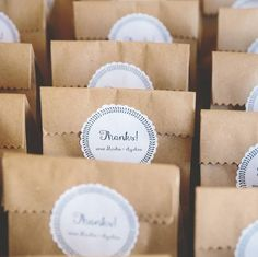 Love these cute little favor bags from today's real wedding! Packaged in brown sacks that are perfect for the camp site setting.  photography: @lovebeephotography // location: Mansfield Outdoor Centre