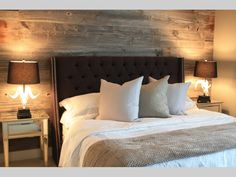 A bland bedroom is transformed into a casual yet polished showcase with barn board used to create a feature wall.