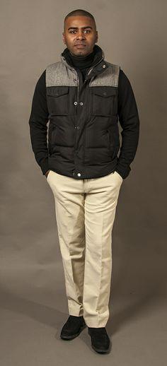 #TommyHilfiger Black & Grey downfilled vest. #HugoBoss winter white pants. #BlackBrown1826 turtleneck #JPliner shoes  Photography by @Sean Harrison