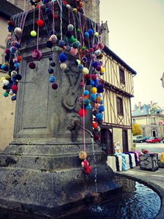 Yarnbombing. With pompoms