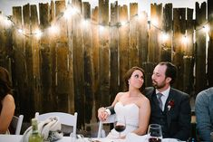 100 year old barn wood as a head table backdrop, cafe lights and looking at your husband like THAT = :) :) :) See the full wedding on the blog! Photo by Gingersnap Photography