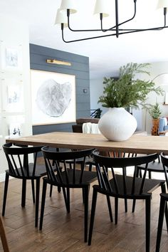 modern black dining room chairs and modern dining room table, large wall art and black shiplap, modern farmhouse dining room design with modern chandelier and neutral dining room decor Home Design, Interior Design, Design Ideas, Design Trends, Modern Interior, Modern Design, Dining Room Design, Dining Room Table, Dining Room Feature Wall