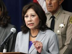 U.S. Secretary of Labor Hilda Solis talks during a news conference at a symposium on human trafficking on Friday Nov. 16,2012 in Los Angeles.