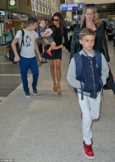 Brooklyn Beckham gives his mum Victoria a rare break and carries his sister Harper | Mail Online