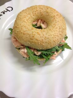 Poached salmon  with rocket and hearbed  cream cheese bagel