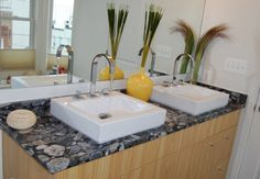 There is a cool modern look in this bathroom by Stone Design. http://www.housetrends.com/specialist/Stone-Design