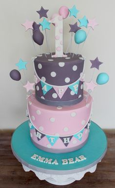 First birthday cake grey turquoise and pink banners garland with balloons and stars and polka dots