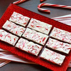 Easy Peppermint Bark recipe made with crushed candy canes, milk chocolate chips, white chocolate chips, and peppermint extract.