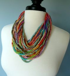 BLENDED TEXTURES AND COLORS.Single crocheted infinity necklace scarf in multi colors. Several different types of yarn and ribbons have been Yarn Projects, Crochet Projects, Crochet Scarves, Crochet Hats, Crochet Stitches, Crochet Patterns, Finger Knitting, Infinity Necklace, Textile Jewelry