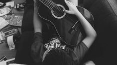#acoustic #acoustic guitar #adult #black and white #books #boy #couch #entertainment #fashion #floor #from above #guitar #guitarist #head #indoors #instrument #man #music #musical instrument #musician #singer #sit #sit