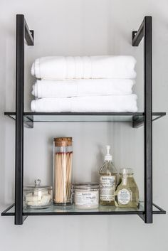 We replaced the dated linen cabinet beside the shower with this modern shelf to hold clean towels. I love this open shelving unit. It's a perfect fit for this space without looking bulky.