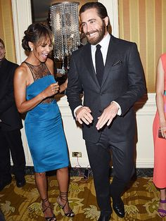 Star Tracks: Friday, August 14, 2015   LAUGHING MATTER   Also inside the banquet, Jake Gyllenhaal and birthday girl Halle Berry (she's 49!) crack each other up during a conversation.