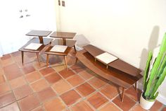 Mid Century Coffee Table and End Tables Set. Two tier tables with tile on top. Stunning atomic design. We are happy to answer any questions or provide additional pictures if needed! SHIPPING: If you need help getting a quote I can assist, just send me your zip code BEFORE BUYING and I will