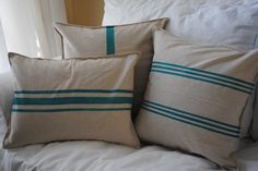 Beautiful burlap pillows from Etsy... I might try to DIY them - the color would blend with our bedspread!