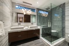 Modern 3/4 Bathroom with Double sink, frameless showerdoor, Pacifica Vessel Sink by Elements of Design, slate tile floors