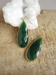 Long and lush emerald teardrops are bezel set in 18K gold vermeil and suspended from 14K gold fill earwires. Rough cut emerald gems are a GORGEOUS green color. They are fully faceted on both sides for maximum sparkle and shine. Each elongated teardrop measures approximately 1 1/2 tall x 5/8 wide! Total hanging length is approximately 1 7/8 from top of earwire. Surprisingly lightweight and easy on the ears. They come with silicon backings for added security. The pop of color is...