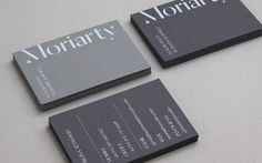 Visual identity and grey business cards with a white block foil detail designed by Bond for London-based event planning business Moriarty