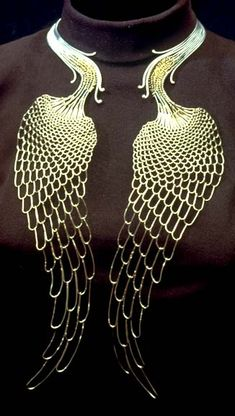 "Imagine going down the back or imagine the ""necklace"" around your waist and the tails could travel down the front or back of your thighs.  (Peacock tails necklace by Mary Lee Hu)"
