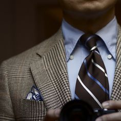 Plaid window pane in off white and brown. Tim Gunn wore a suit similar to this on Project Runway.