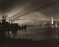 Sydney Harbour Bridge on the night after it officially opened. •Harold Cazneaux•