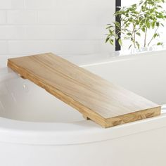 Shop Live Edge Wood Bath Caddy.   Bring nature to the tub with gorgeous teak wood bath caddy, complete with rustic live edges.  An adjustable track along the bottom makes it fit tubs of all sizes.  CB2 exclusive.