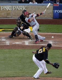 St. Louis Cardinals' Carlos Beltran (3) hits a single to center field driving in two runs off Pittsburgh Pirates starting pitcher Francisco Liriano (47) in the fifth inning of Game 3 of a National League baseball division series on Sunday, Oct. 6, 2013, in Pittsburgh . Pirates catcher Russell Martin is at left. (AP Photo/Tom Puskar)