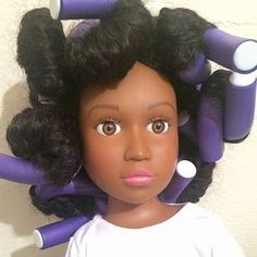 The 18-inch doll's hair is fully style-able. You can wash it, dry it, twist it out, put it up, curl wand, and bantu knot it, if you want. | This Mom Made A Natural Hair Doll To Improve Her Daughter's Self-Esteem